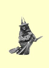 A figue of a witch fying on a broomstick, solid metal.