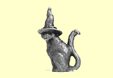 A cat with a witch's hat, solid metal figure,
